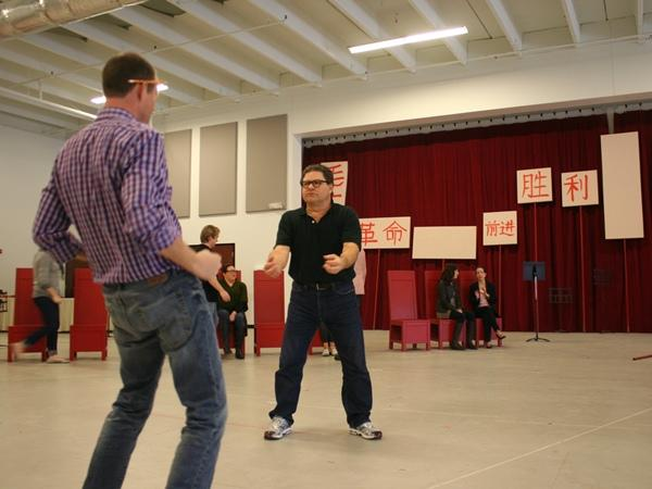 Scenes from a rehearsal: Director Michael Cavanagh and Richard Paul Fink (as Kissinger as brutal landlord Lao Szu) demonstrate hip thrusts.