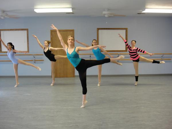 Kendra Short (center) works with students on a dance number at her studio in Belleville, Kan. Short and her husband Shannon have applied for the Rural Opportunity Zone program in Republic County, and are building a house.