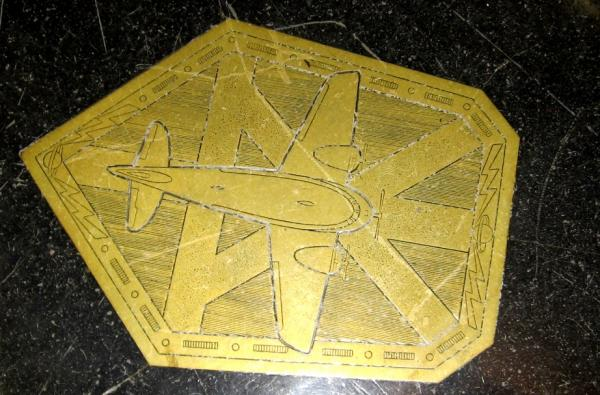 Inlaid tile, floor of City Hall lobby, is 1936-37 motif of importance of air travel to Kansas City.