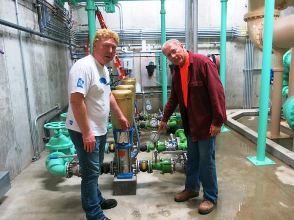 Staunton, Ill., Mayor Craig Neuhaus, left, checks out the town's new water plant with Hank Fey, a public works director.