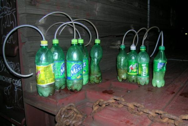 Bottles as they appear after methamphetamine has been cooked under controlled conditions.
