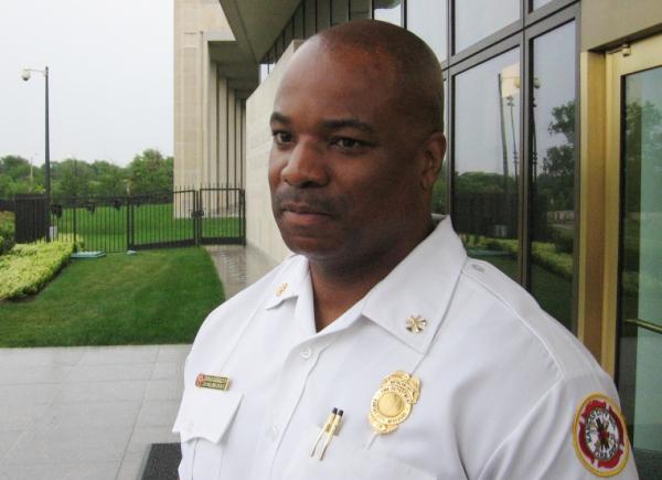 Kansas City Fire Battalion Chief James Garrett outside Federal Reserve Bank.