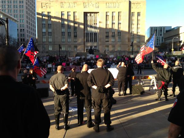 The National Socialist Movement rallied against immigration reform in Kansas City Saturday opposite hundreds of protesters.