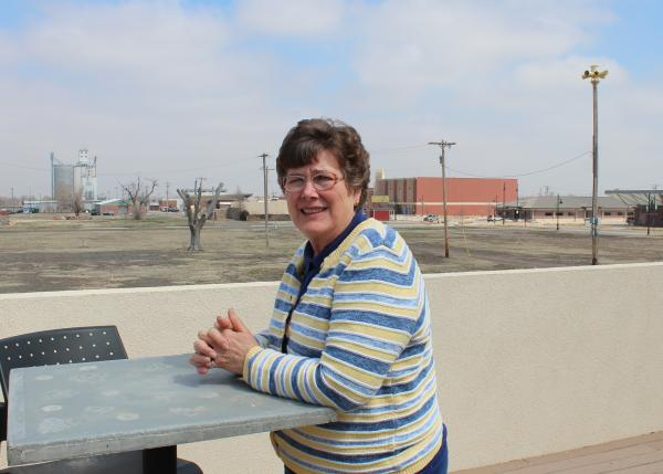 Greensburg Greentown Site Manager Ruth Ann Wedel sits on the second floor patio of an environmentally sustainable, tornado resistant silo home overlooking Greensburg.