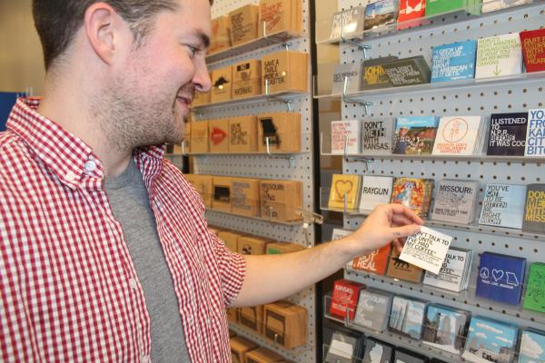 Raygun owner and founder Mike Draper cracks himself up a little bit in his new Kansas City store.