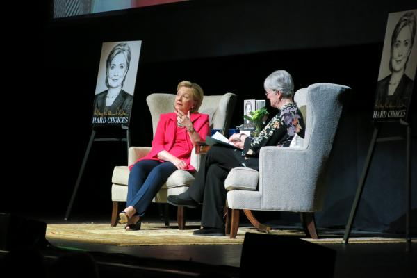 Former Secretary of State Hillary Clinton, left, speaks with Rainy Day Books owner Vivien Jennings Sunday at the Midland Theatre in Kansas City, Mo. Clinton was in town to promote her memoir, 'Hard Choices.'