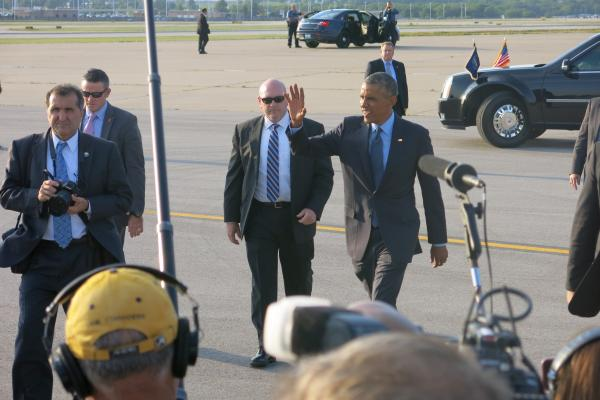 President Obama greets the crowd on the runway at Kansas City International Airport. The president is in town to give a speech on the economy and meet with Kansas Citians who have written him letters.