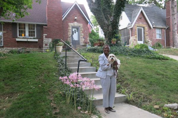 Troostwood Neighborhood Association president Wanda Taylor, pictured here with her dog Faith, says overall, the Green Impact Zone has had a positive impact on where she lives.