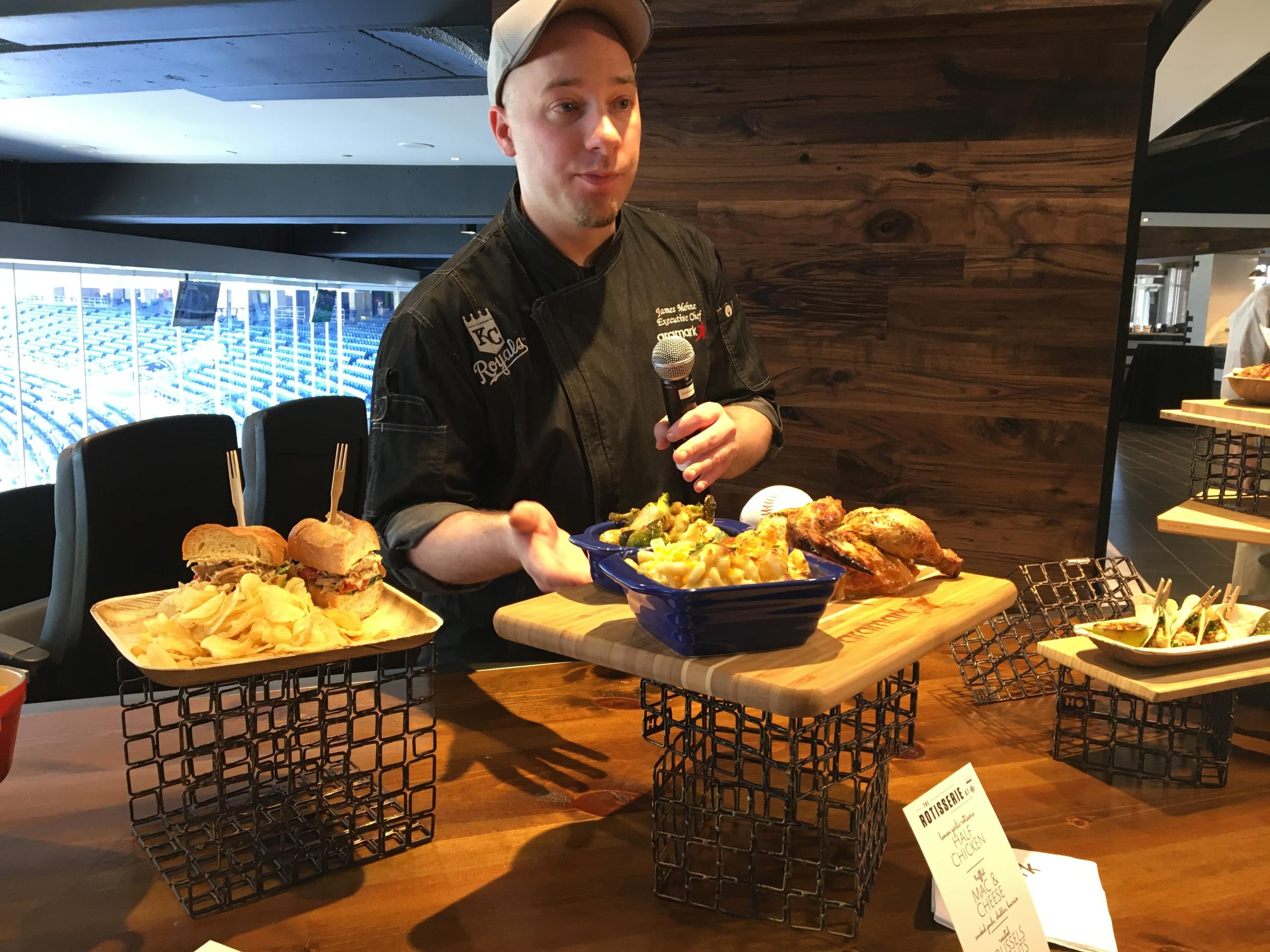 Aramark Executive Chef James Mehne shows off new food items like the truffle mac & cheese and lemon garlic rotisserie chicken during a tour of the renovated Diamond Club at Kauffman Stadium
