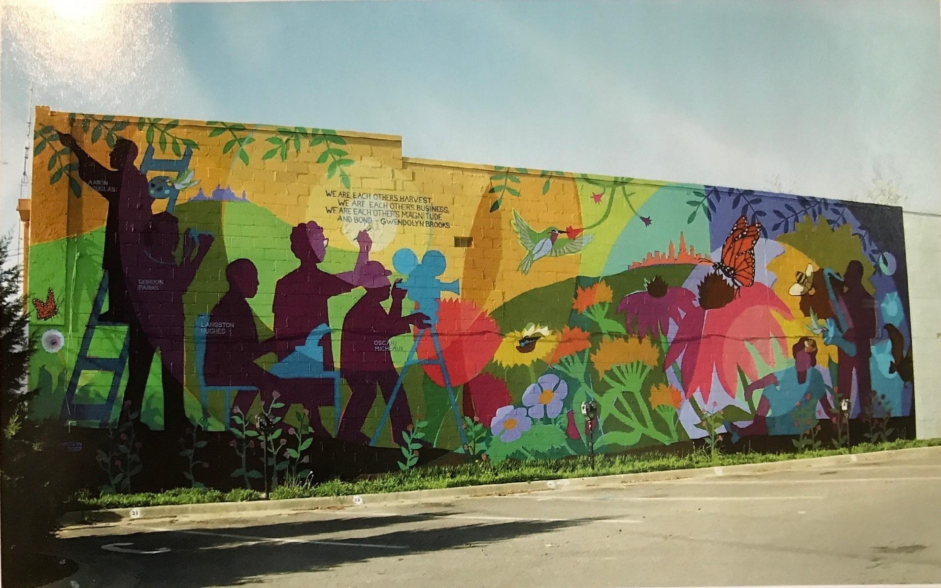 In Downtown Lawrence Artists Bring A Demolished Mural Back To Life