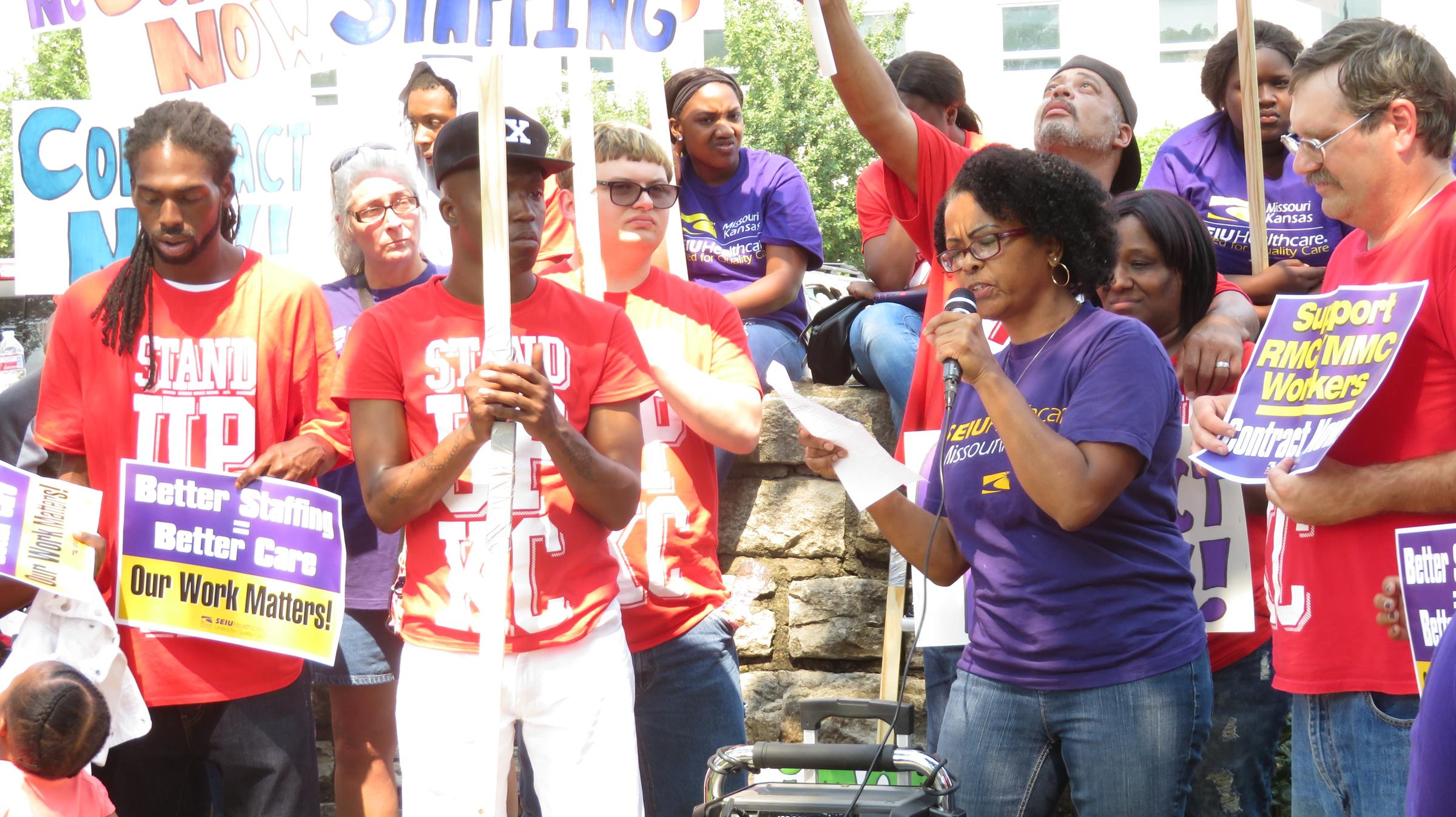 Research Medical Center employee and Service Employees International Union  member Dot Morgan (with microphone) gives a speech at the Labor Day rally.