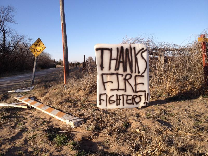 A sign on the western edge of the fire evacuation zone in Reno County, Kansas.