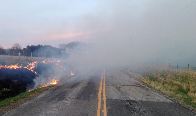 Obscured roadways, such as this one captured during an earlier burn, are one of the many considerations for farmers planning a burn.