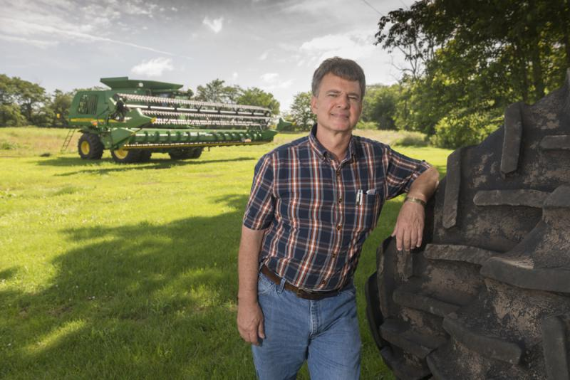 Mike Crawford stands at his farm near Danville, Ill. He says crop insurance is an important risk-management tool for farmers.