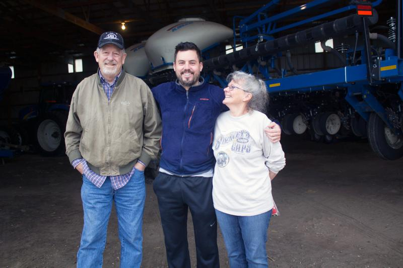 Bob, Robbie and Leah Maass ready equipment for planting season on their farm near Ellsworth, Iowa.