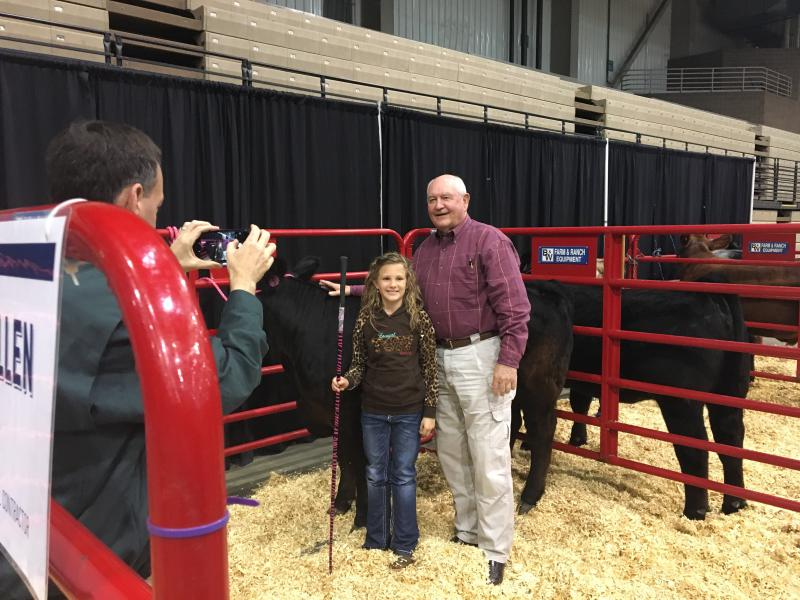 Ag Secretary Sonny Perdue meets with a Missouri girl who shows cattle at the American Royal while visiting Kansas City on April 28.