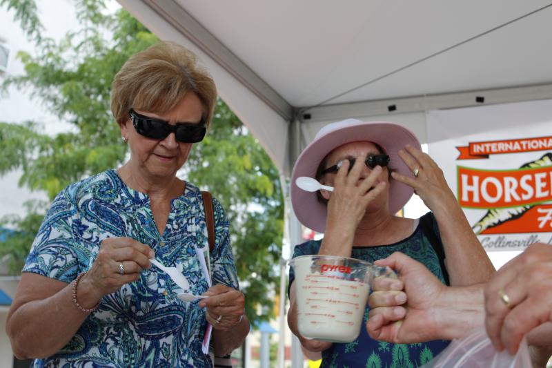 Taste-testers feel the burn after trying some freshly blended horseradish at the Collinsville, Illinois, festival.