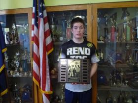 Dylan Wassily (DHS class of 2014) holds the Drew O'Brien Award.