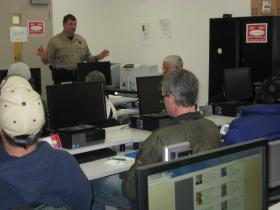 "Wildlife Trooper Burk outlines enforcement priorities during BBEDC's ""Business of Fish"" workshop in Dillingham."