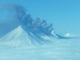 Pavlof Volcano erupting on May 16, 2013. Photo taken from about 6,000 ft, at 10:20 am, by pilot Theo Chesley. This view is looking at the north side of Pavlof; the peak in the foreground is Pavlof Sister.