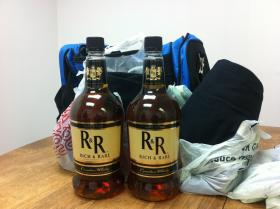 Two half gallons of whiskey recently seized enroute to Togiak.