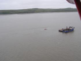 The 78-foot tender Lone Star sits on the bottom of the Igushik River.