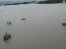 Bristol Bay driftnet vessels waiting for fishing time in the Naknek River.