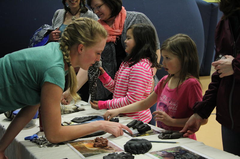 UAF educator Heather Craig showed kids how to identify bird and animal tracks.