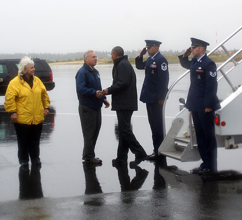 Dillingham Mayor Alice Ruby looks on as Rep. Bryce Edgmon greets President Obama after he landed in Dillingham Wednesday, September 2, 2015.