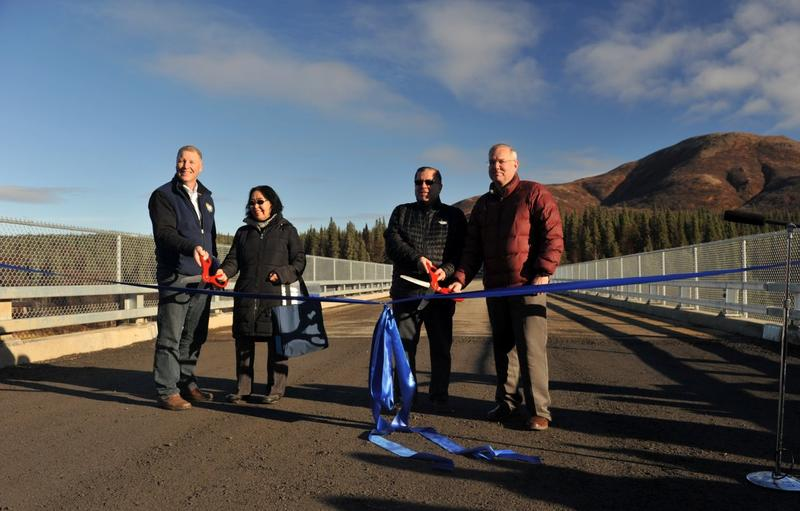 DOT Commissioner Marc Luiken, Aleknagik Mayor Jane Gottschalk, Sen. Lyman Hoffman, and Rep. Bryce Edgmon cut the ribbon on the Aleknagik Wood River Bridge Tuesday, Oct. 13, 2015.