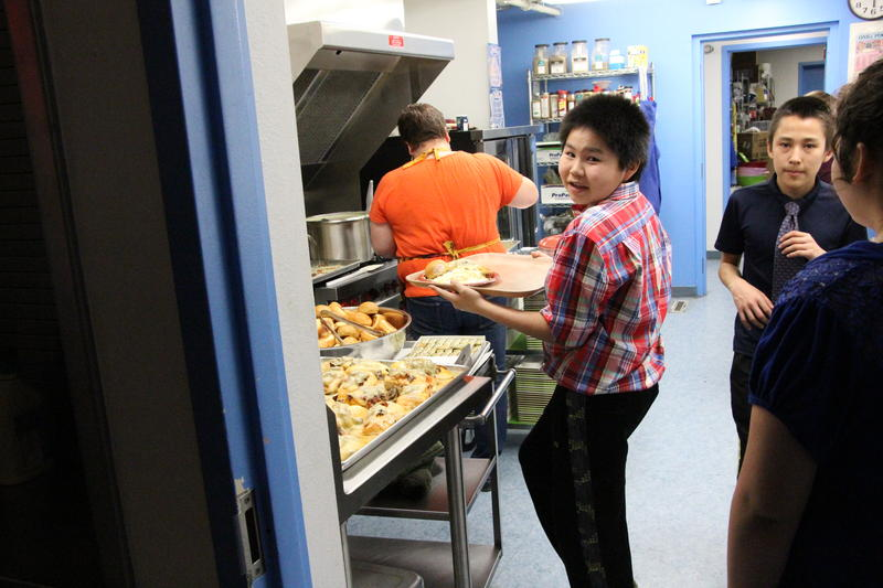 Middle schoolers volunteered to serve the high school prom goers dinner Thursday night in Newhalen.