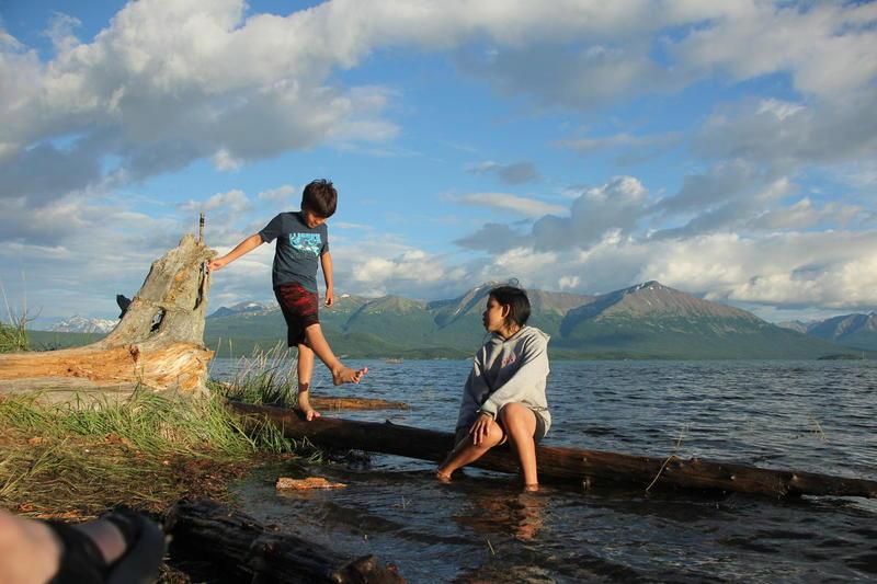 Youngsters enjoying an evening hour along Lake Clark at Kijik summer camp.