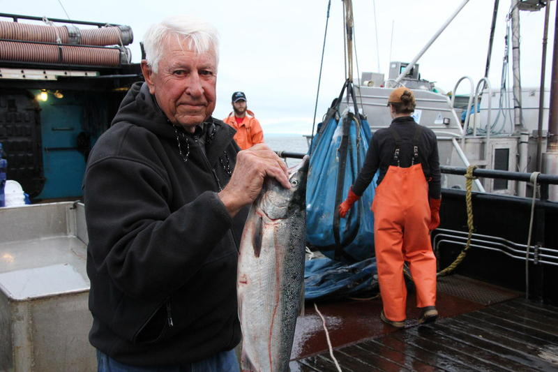 Howard Knutsen holds one of the two billionth salmon caught in Bristol Bay.
