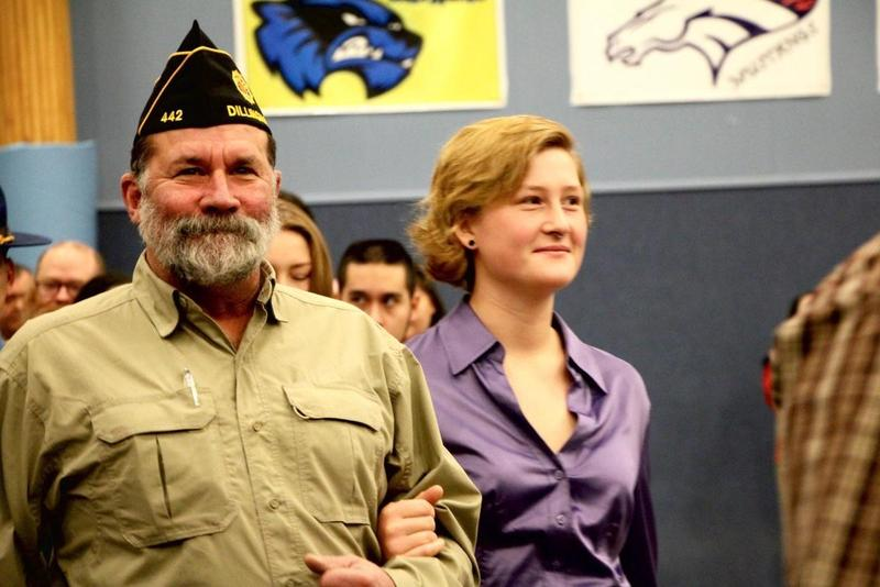Kent Winship being escorted in to the Veterans Day assembly in Dillingham, 2016.