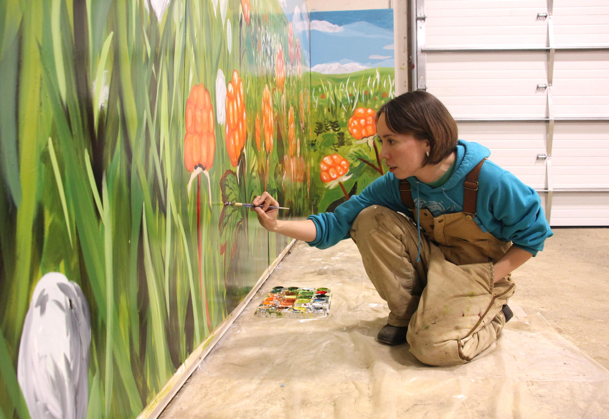 bristol bay muralist paints salmonberries to uplift bethel youth kdlg