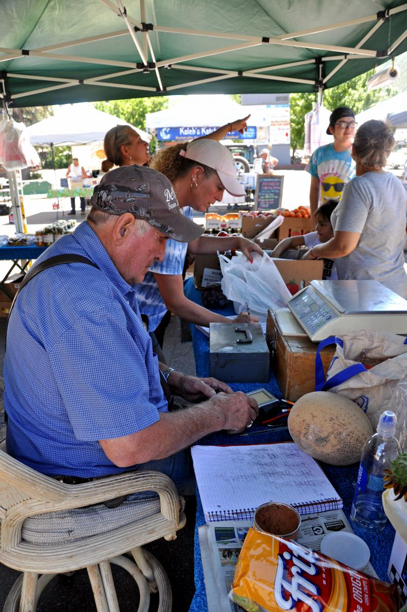 Bill DeVries and family members sell produce at the Glenwood Springs Farmer's Market on the season's opening day, June 29.