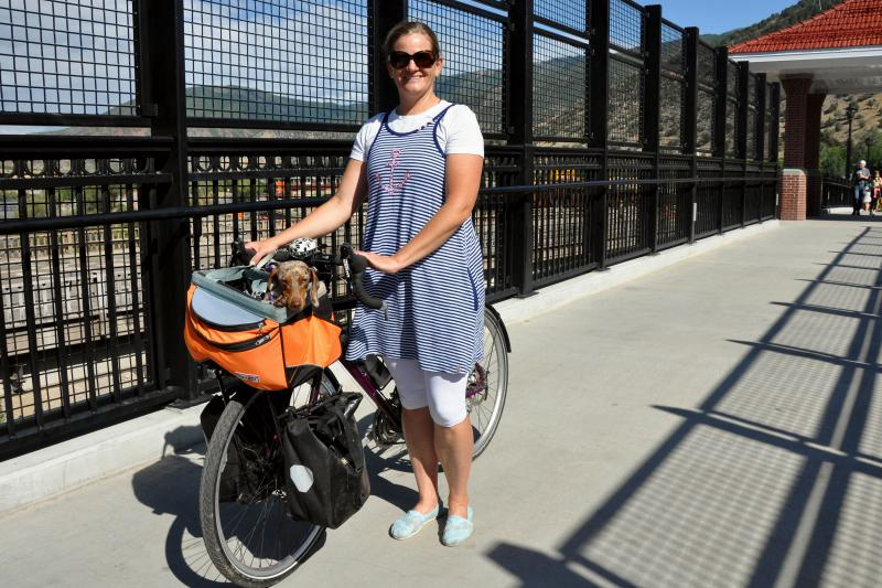 Kearstin Cameron bikes to work at CMC with her dog, Charlotte.