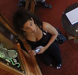 "Suspect 1 wanted by Aspen police in connection with 9/12/17 jewelry heist from an Aspen business.  Young woman, 30's or 40's, young woman, 30's or 40's, 5'8"" with dark brown hair in a loose bun, olive complexion, distinctive nose, wore a long skirt"