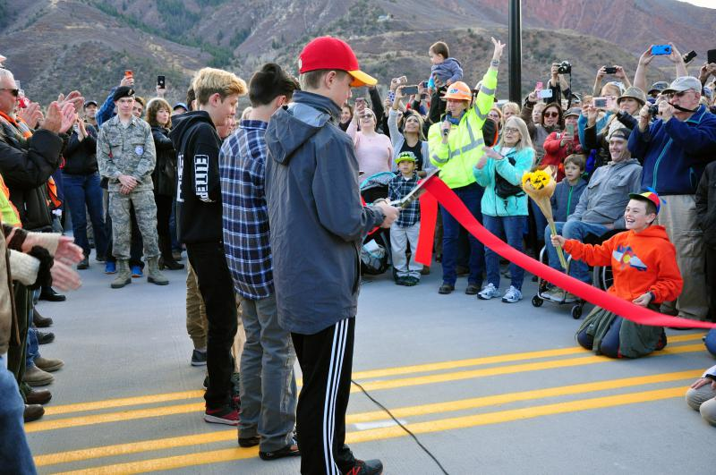 Glenwood Springs Middle School students Dylan West, Cooper Proctor, Elias Gardner, Tom Barton (not pictured) and Forest Williams (not pictured) cut the ribbon, marking the official opening of the Grand Avenue Bridge.