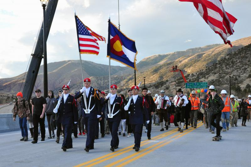 Glenwood Springs High School Air Force JROTC leads the way across the new Grand Avenue Bridge, accompanied by accordions