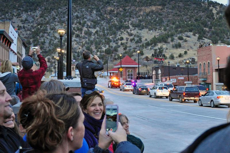 Happy onlookers watch as the first cars cross the new Grand Avenue Bridge in Glenwood Springs.