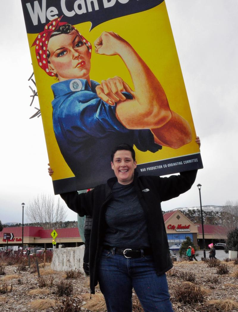 Stacey Baldock supports Rosie the Riveter at Saturday's Carbondale march.