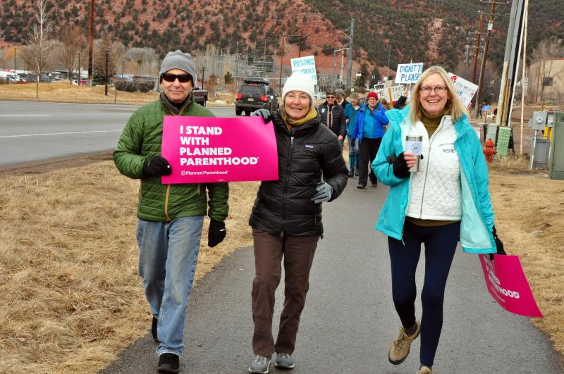 Marge Palmer (r) and friends at Saturday's march.