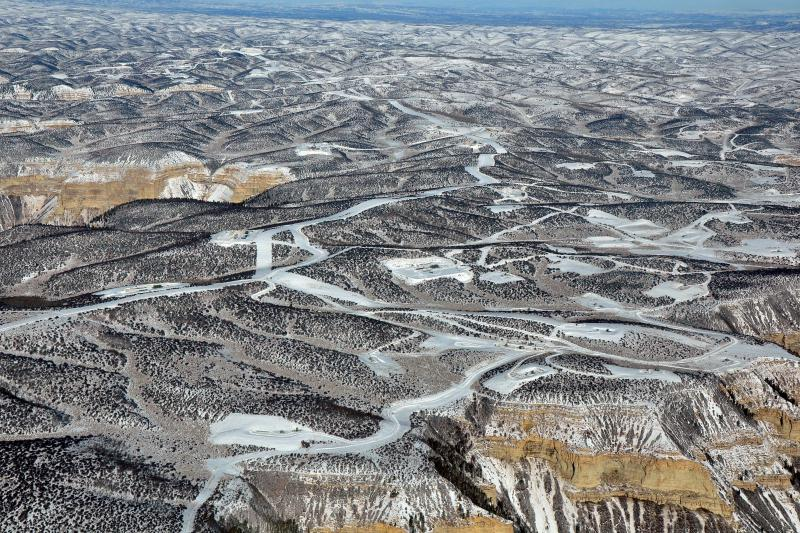 Natural gas drilling infrastructure, top of Roan Plateau, heading north by northeast, January 2018 EcoFlight
