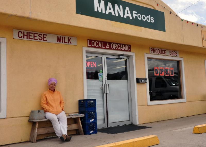 Sotantar sits outside the new Mana Foods in Carbondale.