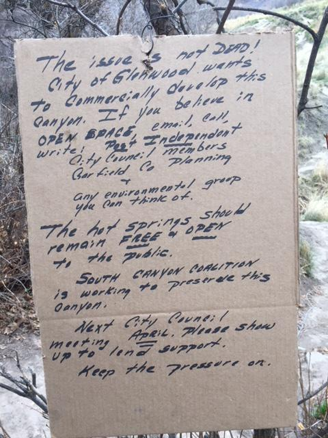 A letter scrawled on cardboard on the trail, urging to not develop the site.