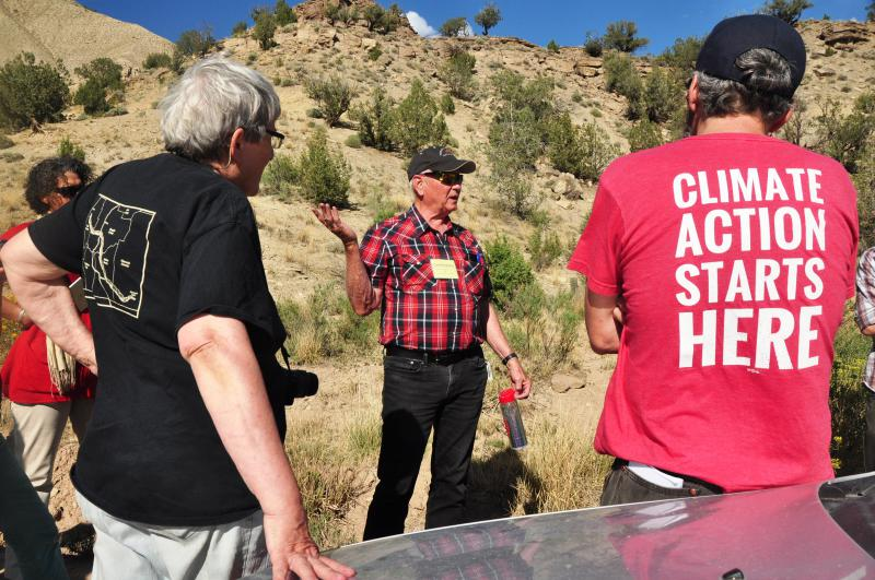 Oregon landowner Frances Eatherington (l, foreground) and Colorado organizer Pete Kolbenschlag (r) listen to Dave DeVanney (center), of Battlement Concerned Citizens, on a tour of natural gas operations in Battlement Mesa and Parachute.