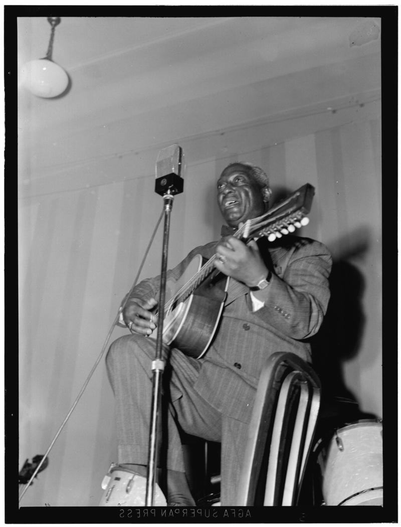 Leadbelly first brought southern black music into the national spotlight by touring the lecture circuit with John and Alan Lomax.