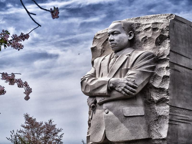 The Martin Luther King Jr. Memorial looks out sternly over the nations capitol, still urging for equal economic opportunity for all Americans.