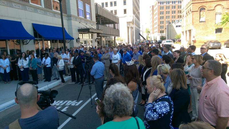 Crowds gather for the ribbon cutting.
